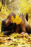 Two friends hide face — Stock Photo