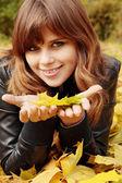 Girl holding leaves — Stock Photo