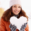 Portrait of a woman with a heart — Stock Photo
