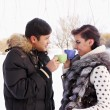 Young couple with a hot drink — Foto de Stock