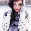 Beauty in a fur vest — Stock Photo