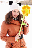 Portrait of a woman with a flower — Stock Photo