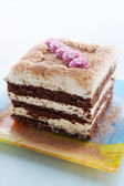 Cake decorated with flowers — Stock Photo