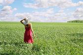 Woman on field — Stock Photo