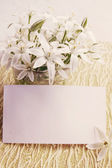 Flowers with a card — Stock Photo