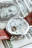 American money and wristwatch — Stock Photo