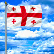 Georgia waving flag against blue sky — Stock Photo #11031981