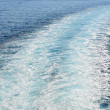 Cruise ship trails in open sea — Stock Photo