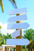 Empty arrow woode signs at beach — Stock Photo