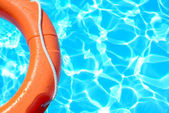 Life buoy in water — Stock Photo