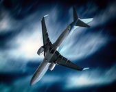 Passenger airplane falling from sky against stormy cloudscape — Stock Photo