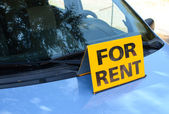 """RENT A CAR"" sign on car - Rent a car concept — Stock Photo"