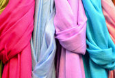 Colorful scarfs background — Stock Photo