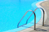 Swimming pool in curved shhape with stairs — Stock Photo