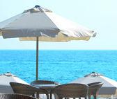 Sun umbrella at seaside — Stock Photo
