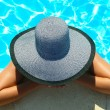 Stock Photo: Woman in swimming pool resting