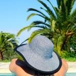 Woman enjoying summer in swimming pool — Stock Photo