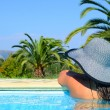 Lady with straw hat enjoying sun - Stock Photo