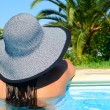 Woman resting in pool area — Stock Photo