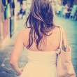 Woman in white dress walking - Rear view — Stock Photo