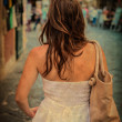Royalty-Free Stock Photo: Vintage image of woman in white dress - Rear view