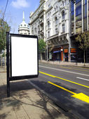 Blank billboard on city bus station — Stock Photo