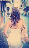 Woman in white dress walking - Rear view — Stock Photo