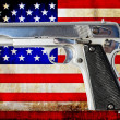 Gun and USA flag — Stock Photo