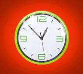 Retro green clock on red background — Stok fotoğraf