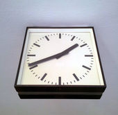 Square station clock hanging on wall — Stock Photo