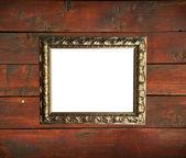 Antiguo marco dorado en pared de madera — Foto de Stock