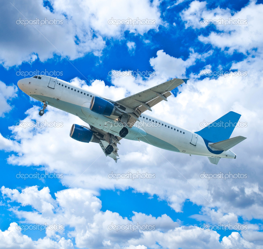 Passenger airplane against blue sky — Stock Photo #13427898
