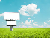 Blank billboard on beautiful field — Stock Photo