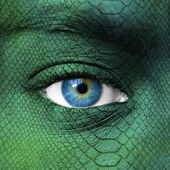 Human face with dragon skin texture — Stock Photo