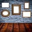 Stock Photo: Retro room with antique picture frames on stone wall