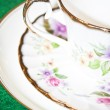 Vintage tea or coffee cup with floral pattern macro shot — Stock Photo
