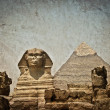 Stock Photo: Vintage image of Sphynx and Cheops pyramid