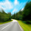 Highway in forest in motion blur - Stock Photo