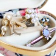 Jewelry box full of gold and accessories — Stock Photo