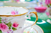 Antique floral tea set macro shot — Stock Photo