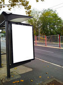 Bus stop with a blank bilboard — Stock Photo