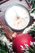 Christmas ornaments and clock - Holidays background — Stock Photo