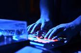 DJ's hand on audio mixer — Stock Photo