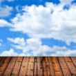Wood floor and blue sky — Stock Photo #14548691