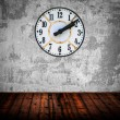 Grunge room with antique wall clock — Stock Photo