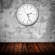 Grunge room with old clock on wall — Stock Photo