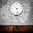Grunge room with old clock on wall — Stock Photo #14550139