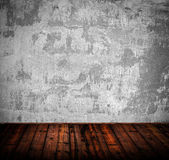 Interior of grunge empty room with white wall and wooden floor — Stock Photo