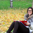 Stock Photo: Smiling girl learning in nature