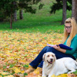 Student girl learning in nature with dog — Stock Photo